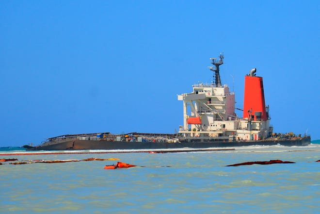 The Japanese MV Wakashio, a bulk carrier ship, recently ran aground off the southeast coast of Mauritius. The oil spill disaster turned deadly this week when a tugboat leaving the shipwreck collided with a barge and sank, killing at least three sailors, police said Tuesday. (AP Photo/ Sumeet Mudhoo-L'express Maurice/File)