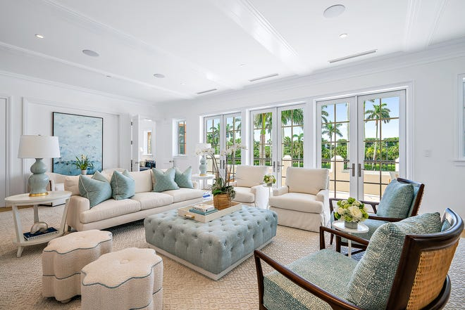 French doors open to the front terrace from the living room of condominium No. 3 at 221 Royal Poinciana Plaza. The condo in the newly completed Via Flagler by The Breakers development is listed for sale at $12.95 million. [CARLOS DIAZ/PELICAN PIX/COURTESY PREMIER ESTATE PROPERTIES]