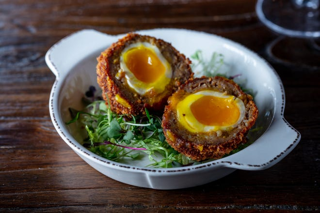 The oversized Scotch egg at Brick and Barrel pub in Abacoa conceals a jammy yolk beneath its crispy exterior. [Photo by LibbyVision.com]