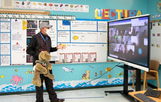 First-grade teacher Alejandro Aponte teaches his dual language class remotely from his classroom at Highlands Elementary in Lake Worth Beach on Monday. Palm Beach County schools opened for the first day of school Monday with all children taking courses online. [LANNIS WATERS/palmbeachpost.com]