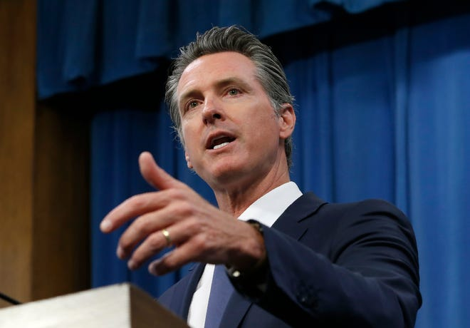 FILE - In this July 23, 2019, file photo, Gov. Gavin Newsom talks to reporters at his Capitol office, in Sacramento, Calif. California lawmakers on Monday, Aug. 31, 2020, moved to use the most populous state's market power to lower the cost and increase the availability of prescription drugs for its nearly 40 million residents, with supporters citing the coronavirus pandemic as proof that more is needed to reduce shortages in drugs and other medical supplies. (AP Photo/Rich Pedroncelli, File)