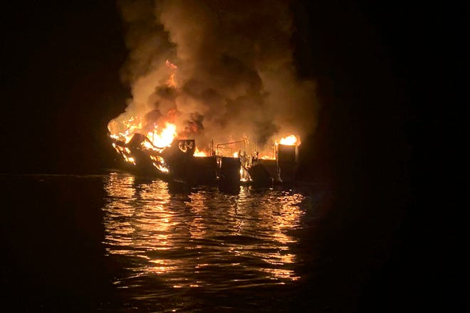 The dive boat Conception is engulfed in flames after a deadly fire broke out aboard the commercial scuba diving vessel off the Southern California Coast in September 2019.