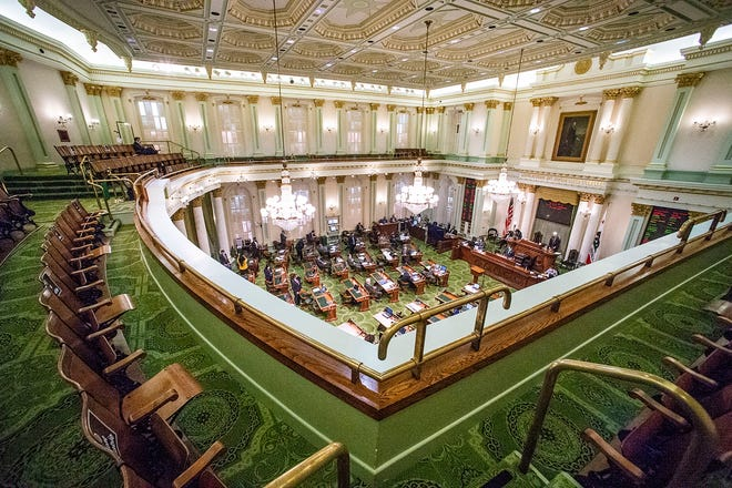 An almost empty Assembly gallery is seen during session in Sacramento, Calif., on Monday, Aug. 31, 2020. Lawmakers have until midnight Monday to finish all business before the end of the two-year legislative session. (AP Photo/Hector Amezcua)