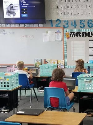 Students sit with plenty of social distance between them at Grenada Elementary, which began the 2020/21 school year in person and will transition to distance learning.