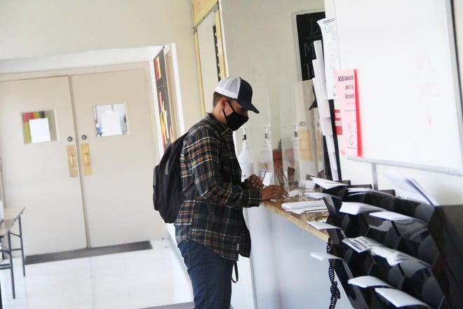 A student checks into the office at Yreka High School on Thursday, Aug. 27.