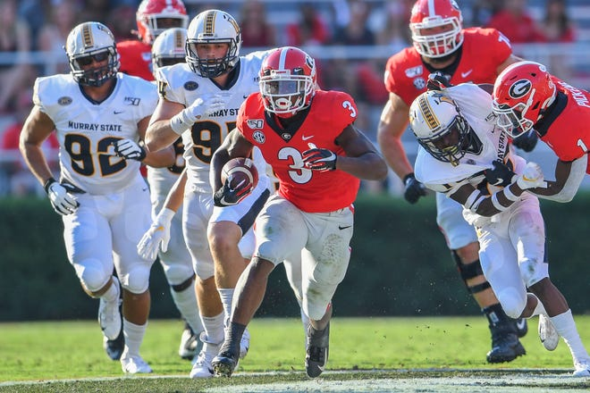 Scotland High graduate Zamir White (3) runs for yardage last season for Georgia against Murray State. White, a sophomore, is expected to be the Bulldogs' starter this season. (Dale Zanine/USA TODAY Sports)