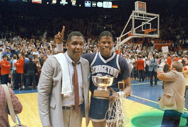 """FILE - In this March 9, 1985, file photo, Georgetown NCAA college basketball head coach John Thompson poses with player Patrick Ewing after Georgetown defeated St. John's in the Big East Championship in New York. John Thompson, the imposing Hall of Famer who turned Georgetown into a """"Hoya Paranoia"""" powerhouse and became the first Black coach to lead a team to the NCAA men's basketball championship, has died. He was 78 His death was announced in a family statement Monday., Aug. 31, 2020. No details were disclosed.(AP Photo/File)"""