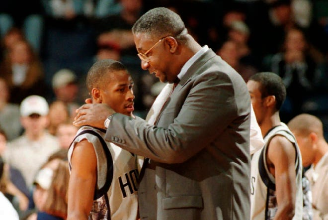Former Georgetown coach John Thompson, right, counsels star guard Allen Iverson in this photo from January 1996.