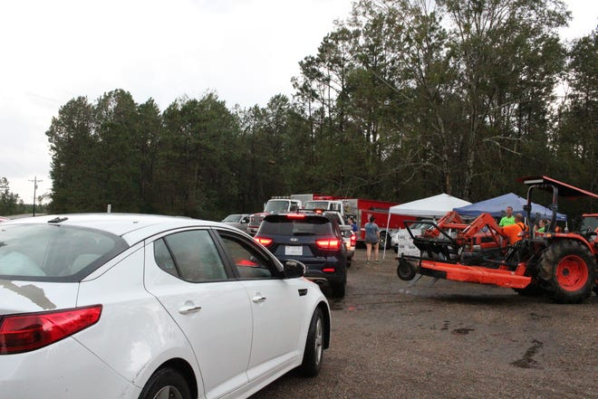Cars line up Monday to pick up supplies at the Plainview Volunteer Fire Department. Since Hurricane Laura hit last week, the department has been trying to get essentials for residents in the southwestern Rapides Parish community.