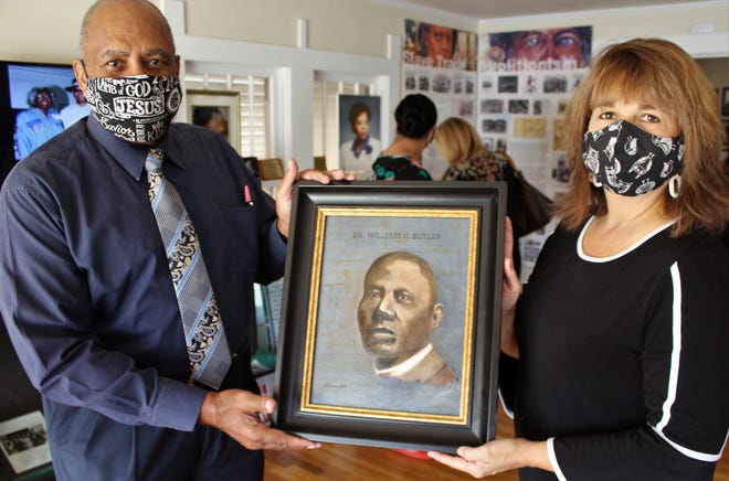 The Rev. Andrew Penns and Laura Moore, executive director of The Grace Museum, show Gary Goodnight's recent painting of Dr. William H. Butler, Abilene's first Black physician. It will be displayed at Curtis House, a museum dedicated to local Black history. Grace staff toured the former home of a funeral home family in hopes of partnering with Penns and those who assist him at the museum.