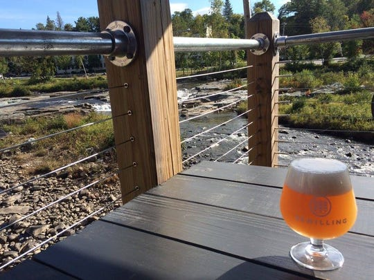 A Belgian-style pale ale with a view of the Ammonoosuc River at Schilling Beer Co. in Littleton, New Hampshire.