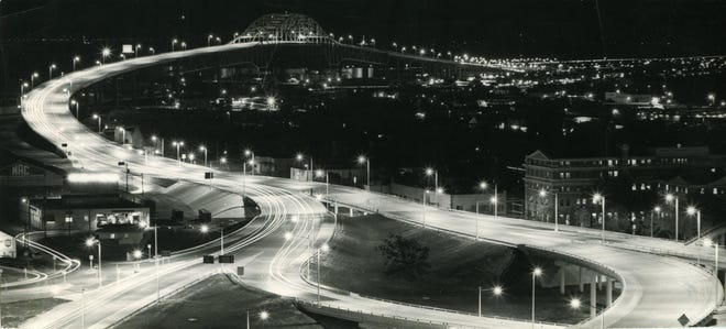 Traffic travels along the Harbor Bridge in this undated night photo.