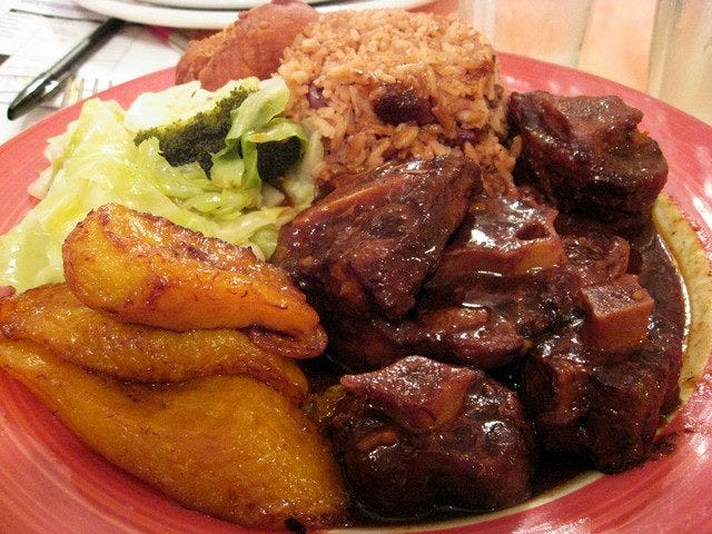 """Oxtails, plantains, rice and beans, and cabbage are traditional Caribbean treats; these are from Michelle's Kitchen and Catering Service in Vineland. Variations of rice and beans are found in much pan-African cooking. Jazz great Louis Armstrong, a native of New Orleans, used to sign his letters """"red beans and ricely yours."""""""