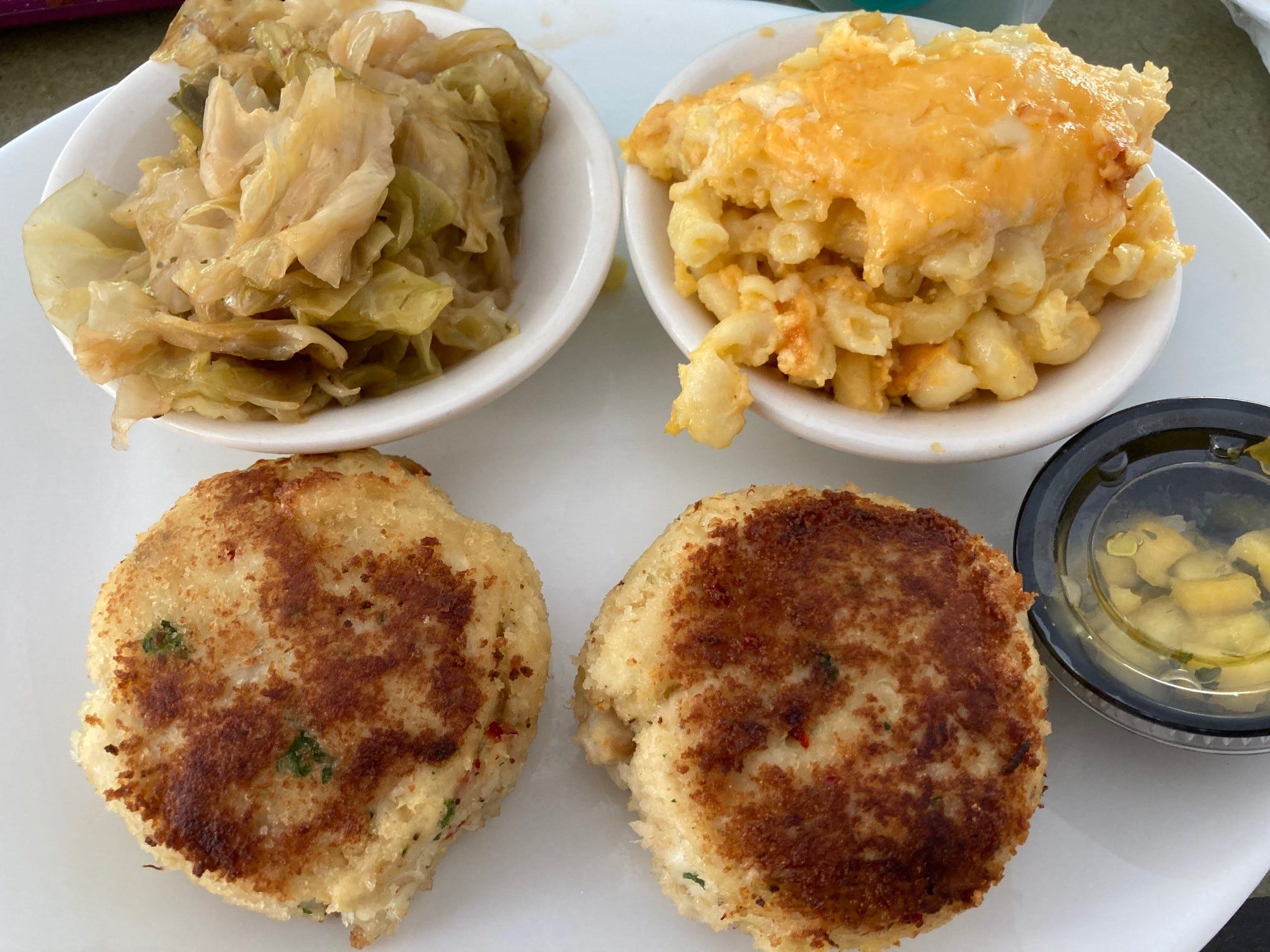 The pan-seared lump crab cakes draw people in at Kelsey's in Atlantic City.  Shown here with cabbage and macaroni and cheese, two other show stoppers. The supper club brings in national and local music acts as well.