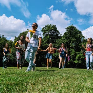 The cast of Godspell practice for the production at Pyramid Hill Sculpture Park and Museum.