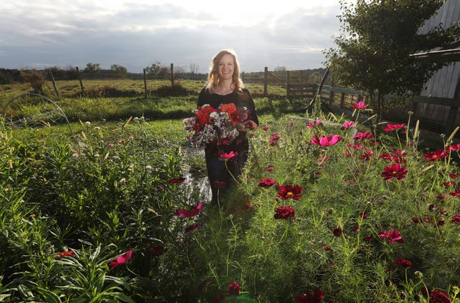 Renee Whinnery grows flowers and raises sheep at Whinmont Farm near Warsaw.