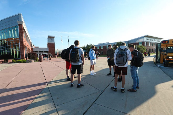 A group of students wait for doors to open for their first day of the 2020-21 school year Tuesday, Sept. 1, 2020 at Fond du Lac High School in Fond du Lac, Wis.