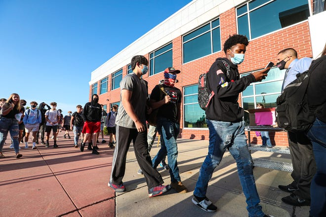 Students arrive for their first day of the 2020-21 school year Tuesday, Sept. 1, 2020 at Fond du Lac High School in Fond du Lac, Wis.