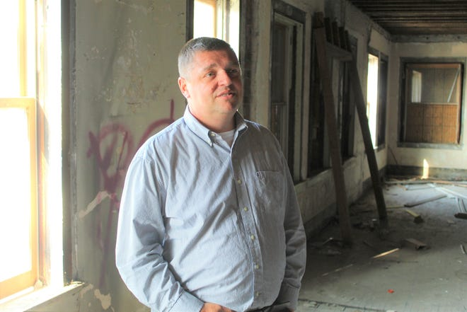 Bob Gross, Fremont's economic development director, stands inside the Jackson Annex building Tuesday morning. The city purchased the Jackson Annex and an adjacent Birchard Street building in July, with hopes of tearing both structures down and replacing them with a new amphitheater.