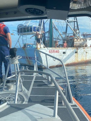 The Kayden Nicole, a commercial fishing boat out of Fort Myers, was assisted by the U.S. Coast Guard Tuesday after the craft began taking on water northwest of Key West.