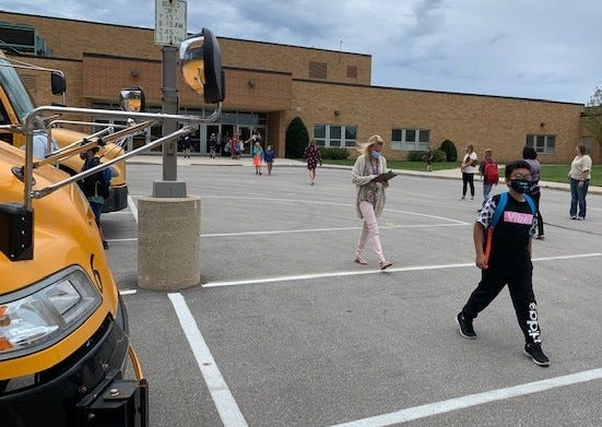 Students head for their buses Sept. 1 at the end of their first day of in-person school since March for the Kewaunee School District. This week, a second grade class and one group of high school students were quarantined after three students and three teachers tested positive for the COVID-19 virus.