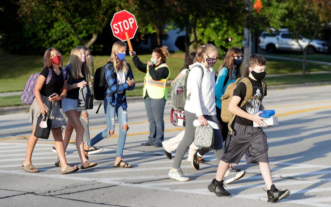 Students wear masks to school on Sept. 1, 2020.