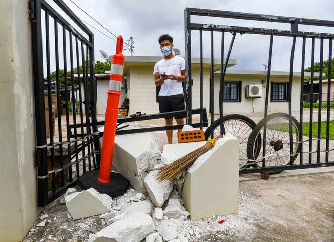 """Resident Lanz Dizon surveys the damage to the front gate of his family's Dededo home on Tuesday, Sept. 1, 2020, after a Guam Fire Department fire engine crashed into it on Sunday night. A fire engine """"rolled forward"""" and into the concrete/metal fence and gate, while GFD personnel were responding to an emergency call in the area, said GFD firefighter Kevin Reilly. No injuries were reported in the incident but an internal investigation has been launched by GFD to determine whether fault may be due to operator and/or mechanical errors, Reilly added. Despite damage sustained to the vehicle in the collision, the unit remains in service. The incident was captured on a surveillance video system in the family's home."""