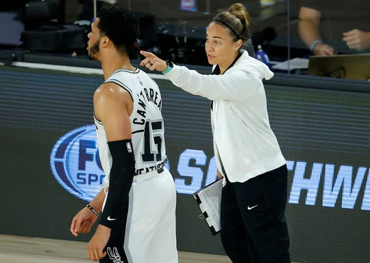 Spurs assistant coach Becky Hammon talks with Quinndary Weatherspoon #15 of the San Antonio Spurs during the third quarter at HP Field House.