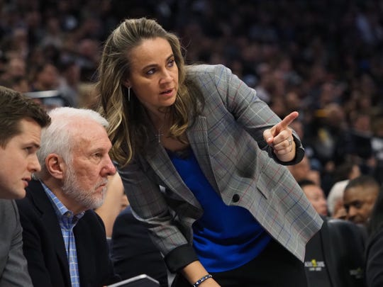 San Antonio Spurs assistant coach Becky Hammon speaks to head coach Gregg Popovich during the fourth quarter against the Sacramento Kings at Golden 1 Center.