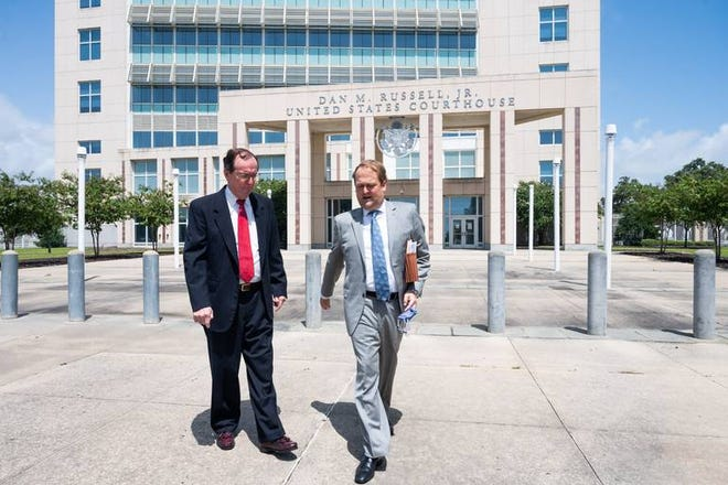Scott and Bill Walker leave the federal courthouse in Gulfport after Bill Walker's initial appearance Sept. 1, 2020, for failing to pay court-ordered restitution. The father and son were convicted of conspiring to defraud the federal government. Scott Walker has also stopped making restitution payments.