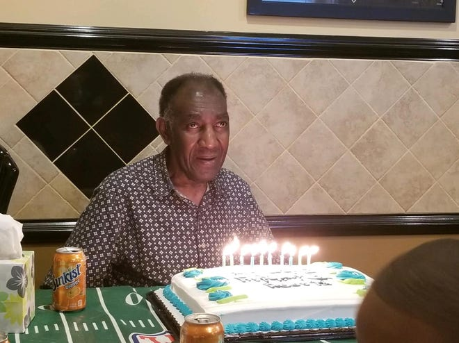 John Charles Lewis Sr. blows out his candles for his birthday. Lewis died of carbon monoxide poisoning Thursday, joining four of his family members who died earlier.