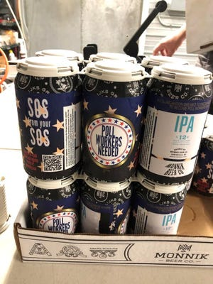 Kentucky's secretary of state and the Kentucky Guild of Brewers are putting labels on beer cans to encourage people to register to vote and volunteer as poll workers for the November election.