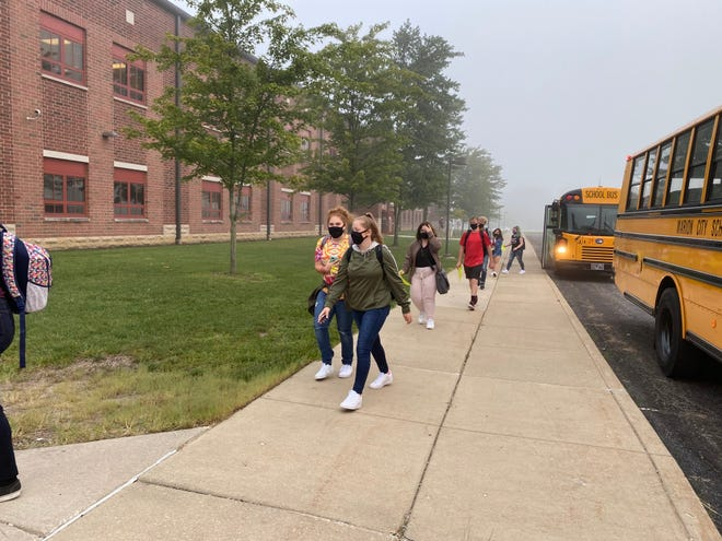 Students exit the school buses to enter Harding High School for their first day of school Tuesday, Sept. 1, 2020.