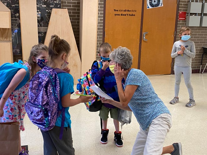 Classroom aide Jean Curtis helps children find their class on the first day of school at George Washington Elementary Tuesday, Sept. 1, 2020.