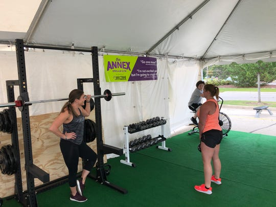 """There are several pieces of workout equipment at """"The Annex,"""" including fitness bikes and dumbbells."""
