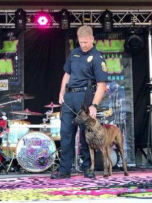 Waukesha Police Capt. Dan Baumann stands beside K9 Emma, who was in training to join the police force. The police dog came to the Police Department courtesy of the Emma Loves Dogs Foundation, created by the Mertens family of Hartland in remembrance of their daughter Emma, who died of an uncommon brain tumor in November 2019.