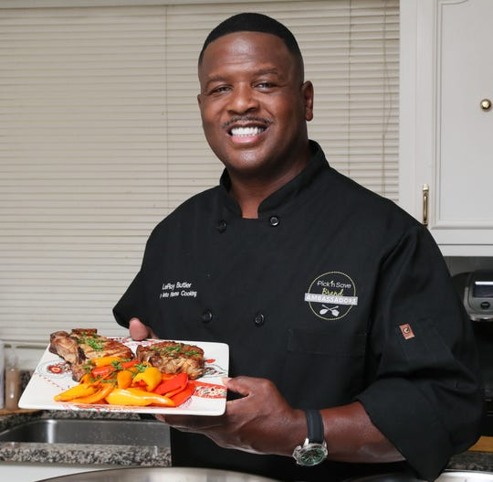 LeRoy Butler shows his LeRoy's Rosemary Pork Chops at his Racine-area home. He is wearing one of his chef coats.