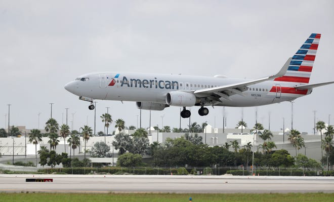 An American Airlines Boeing 737-823 lands at Miami International Airport, Monday, July 27, 2020, in this file photo.