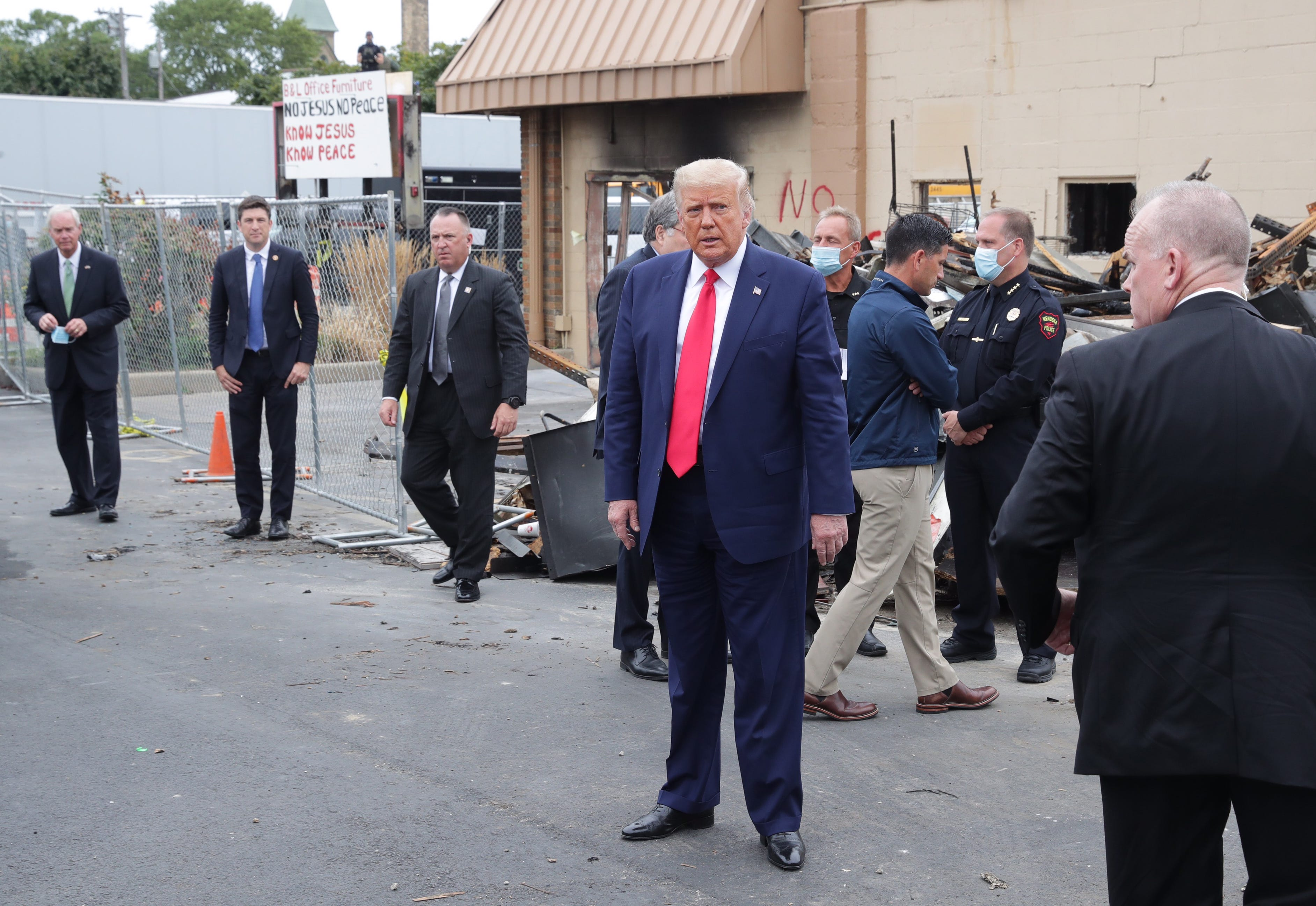 President Donald Trump inspects the remains of B&L Office Furniture on Tuesday, Sept. 1, 2020, in Kenosha, Wis.