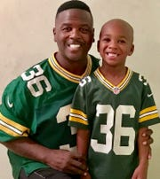 LeRoy Butler and his youngest child, LeRoy IV, don a familiar jersey.