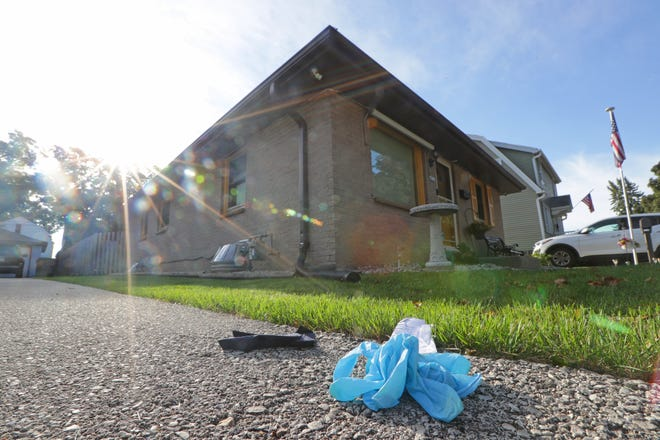 Material from life-saving efforts is seen on a driveway near where a community service officer for the Milwaukee Police Department was shot and killed on Monday near South 22nd Place and West Carpenter Avenue, just south of West Layton Avenue in Milwaukee.