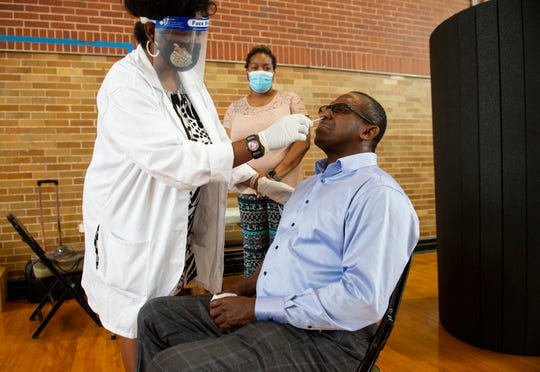 State Sen. Bobby Singleton gets a coronavirus test at Lockhart Gym on Alabama State University campus in Montgomery, Ala., on Tuesday, Sept. 1, 2020.