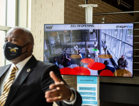 ASU Quinton Ross shows off social distancing technology at the Hardy Student Center on Alabama State University campus in Montgomery, Ala., on Tuesday, Sept. 1, 2020.
