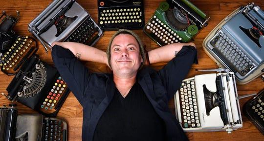 Kirk Jackson poses in his Goodlettsville home with some of the manual typewriters he collects, repairs and sells on Sept. 1, 2020.