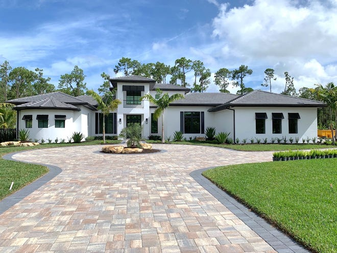 The Brentwood model home, recently completed by Cintron Custom Builders,  features 6,053 square feet of living space with a total of 8,488 square feet.