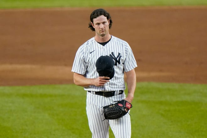 New York Yankees starting pitcher Gerrit Cole reacts on the mound after allowing a two-run home run to Tampa Bay Rays' Ji-Man Choi during the first inning of a baseball game, Monday, Aug. 31, 2020, at Yankee Stadium in New York. (AP Photo/Kathy Willens)