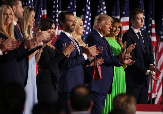 President Donald Trump, third from right, reacts as he stands with his family members after delivering his acceptance speech for the Republican presidential nomination on the South Lawn of the White House on Thursday, Aug. 27, 2020, in Washington, D.C. (Alex Wong/Getty Images/TNS)