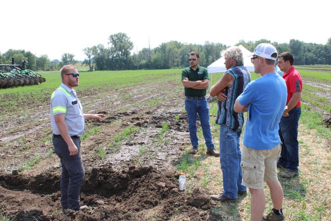 Jesse Dvorchak, left, talks with participants at the Calumet County Ag Stewardship Alliance field day