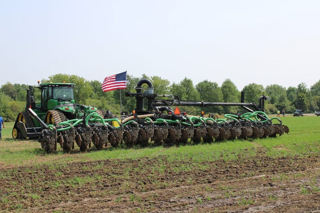 Farmers and non-farmers alike attended the Calumet County Ag Stewardship Alliance's  first field day to see different methods of applying manure into and on the soil to give crops the most benefit from the organic nutrients.