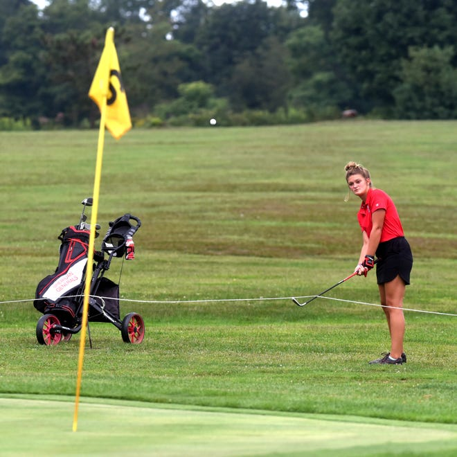Shauna White chips on to the sixth green during Sheridan's trimatch win against host Crooksville and John Glenn on Monday at Perry Country Club. White earned medalist honors with 41.